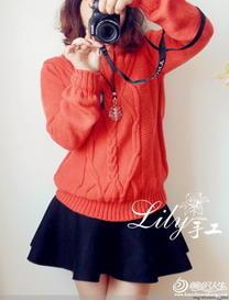 橙红绞花宽松棒针编织女士毛衣