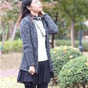 粗棒针编织黑色夹花开衫毛衣