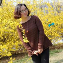 新款手编女士毛衣款式之别致的棒针A字圆领毛衣