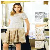 志田花样编织的米色女士短袖套衫