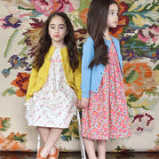 与连衣裙混搭出甜美公主范儿的多款儿童棒针开衫