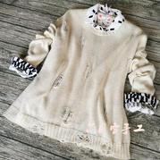 乞丐衣衫已成时尚 女士棒针破洞长袖套头毛衣