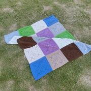 从中心织起的棒针叶子花拼花毯编织图解