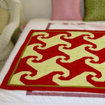 旧线编织的拼布风格棒针小毯子